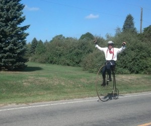 This image has an empty alt attribute; its file name is BikeRider-300x251.jpg